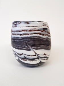 Ceramics egg vessel using porcelain and found materials designed to be held.  Fragile and stunningly beautiful