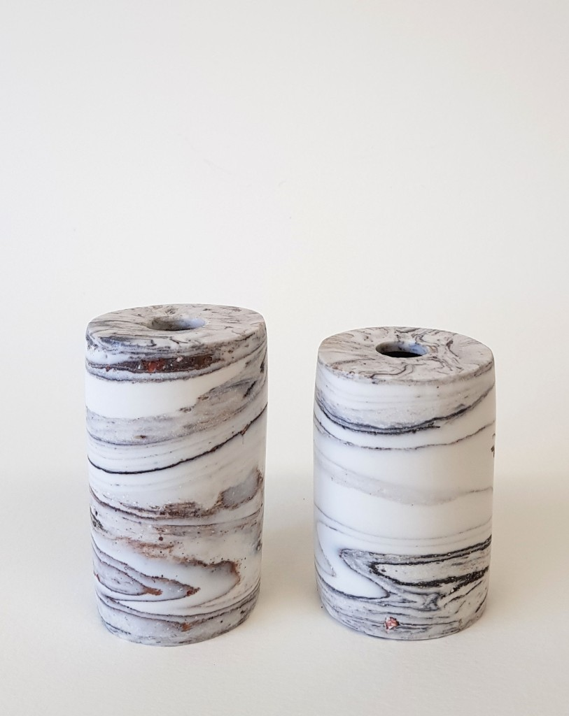 Porcelain ink wells made with found materials and polished